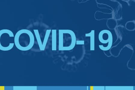 The Covid 19 virus floating in the background with the word Covid 19 overlayed on top